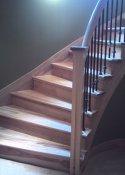 Natural wood basement stairs