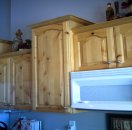 Side view of knotty alderwood kitchen cabinets that were refinished.