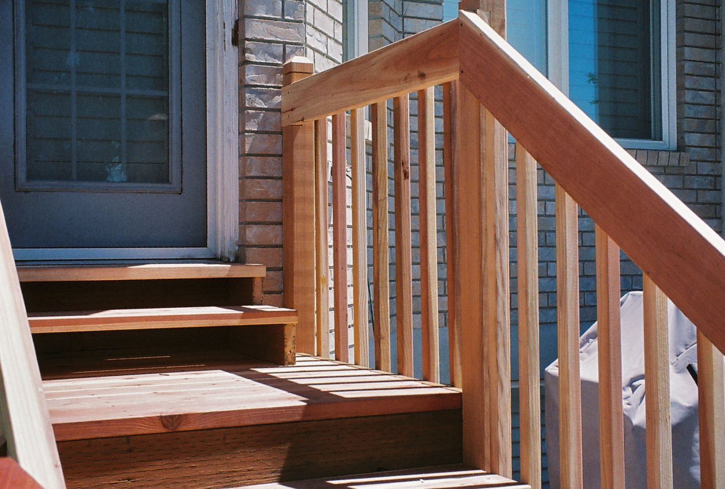 Stained redwood decks closeup of northdeck stairs and inside railing baanklon Image collections
