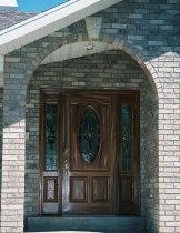 Front view of home with fiberglass door with side panels