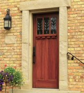 Red mahogany woodgrained door front view.