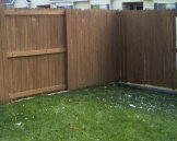 South east corner of a stained apartment fence