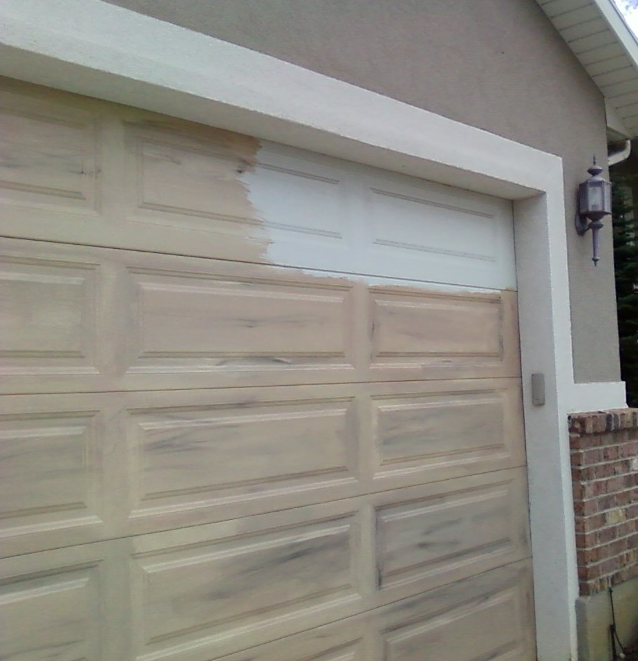 Matching woodgrained entrance garage doors for Garage door with entry door