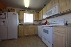 White wood kitchen cabinets  wood grained to match white oak.