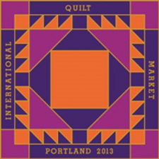 Registered and ready to go to International Spring Quilt Market 2013.