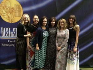Minky Couture team accepts Best of State Award for Best Gift