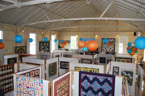 Interior View of Chautaugua Hall with Quilts