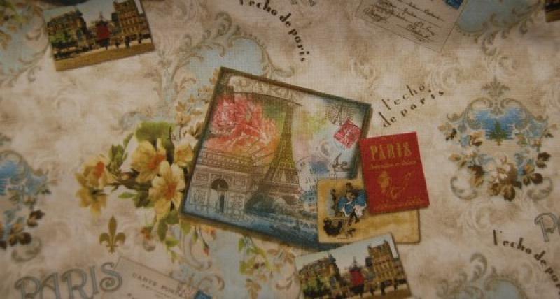 T226 scatter print of nostalgic paris france postcards on a floral background cotton fabric