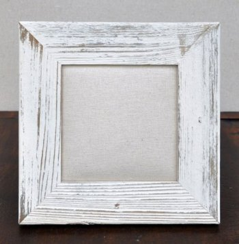 frame is shown at left with one of our lil woolies blocks and also with a simple osnaburg material neither is included