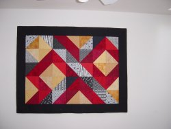 Half square triangle modern quilt