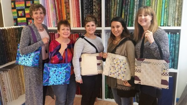 Lisa with sewing students
