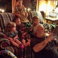 Steve Reading to grandchildren