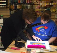 Stitching in a needlepoint class