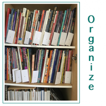 Organized Quilt Books in Bookcase