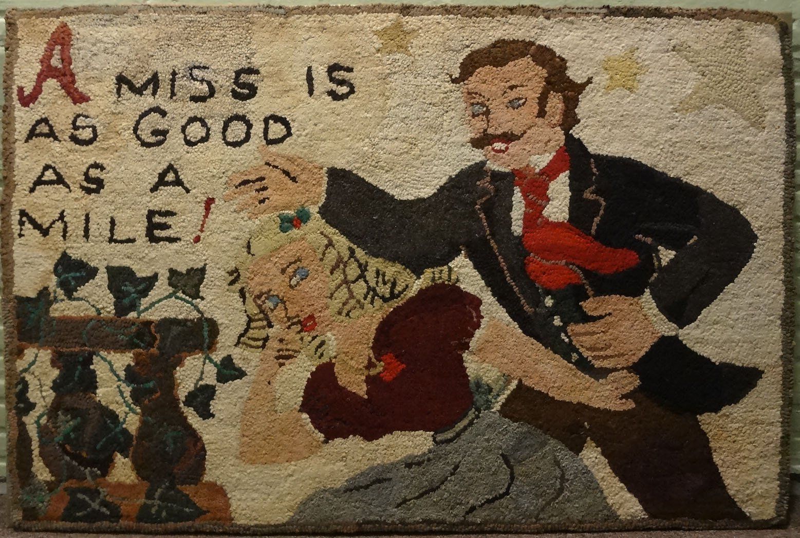 HUTCHINSON 'A MISS IS AS GOOD AS A MILE' ANTIQUE HOOKED RUG